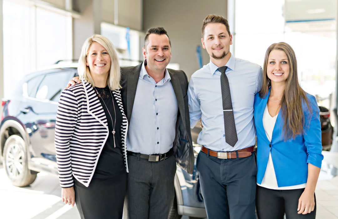 dealership-sales-team-smiling-together